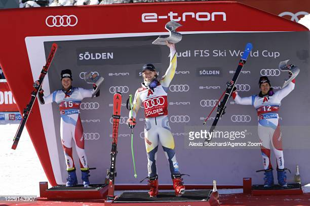 Marco Odermatt of Switzerland takes 2nd place, Lucas Braathen of Norway takes 1st place, Gino Caviezel of Switzerland takes 3rd place during the Audi...