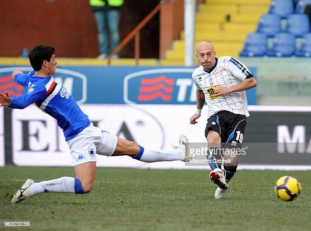 Marco of UC Sampdoria battles for the ball against Ernesto Javier Chevanton of Atalanta BC during the Serie A match between UC Sampdoria and Atalanta...