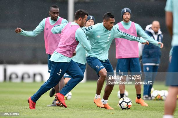 Marco Olivieri and Alex Sandro during the Juventus training session at Juventus Center Vinovo on May 2 2018 in Vinovo Italy