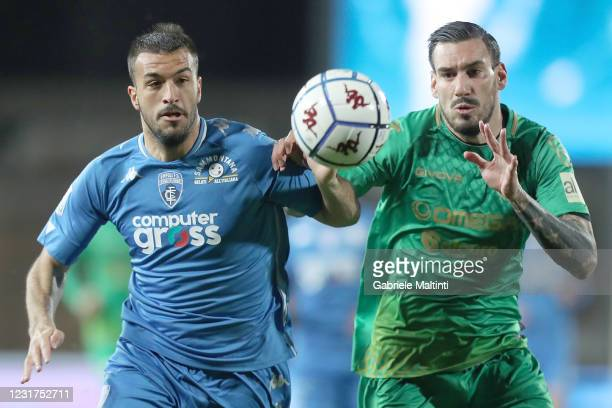 Marco Olivieri of Empoli FC battles for the ball with Nicola Falasco of Pordenone Calcio during the Serie B match between Empoli FC and Pordenone...