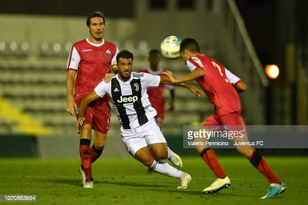 Marco Olivieri of Juventus U23 is challenged during the Coppa Italia Serie C match between Juventus U23 and Cuneo at Moccagatta Stadium on August 21...