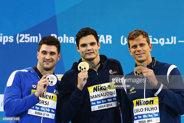 Marco Orsi of Italy Florent Manaudou of France and Cesar Cielo of Brazil celebrates on the podium after the Men's 50m Freestyle Final during day...