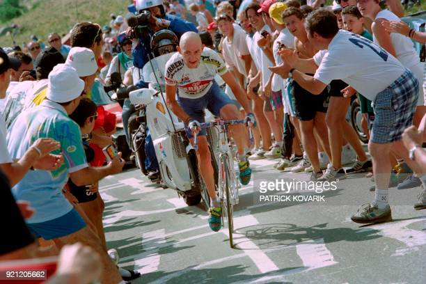 Marco Pantani of Italy rides through the crowd on July 12 during the Alpe d'Huez Climb Pantani won the stage after a breakaway and Miguel Indurain of...