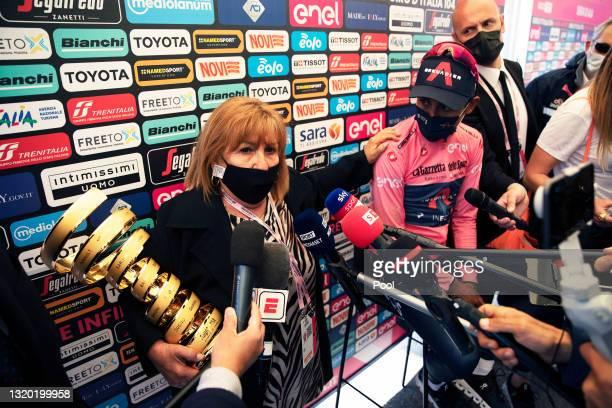 Marco Pantani's mother Tonina Pantani & Egan Arley Bernal Gomez of Colombia and Team INEOS Grenadiers Pink Leader Jersey celebrate at podium during...