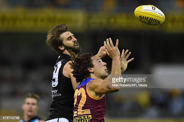 Marco Paparone of the Lions competes for the ball with Justin Westhoff of the Power during the round seven AFL match between the Brisbane Lions and...