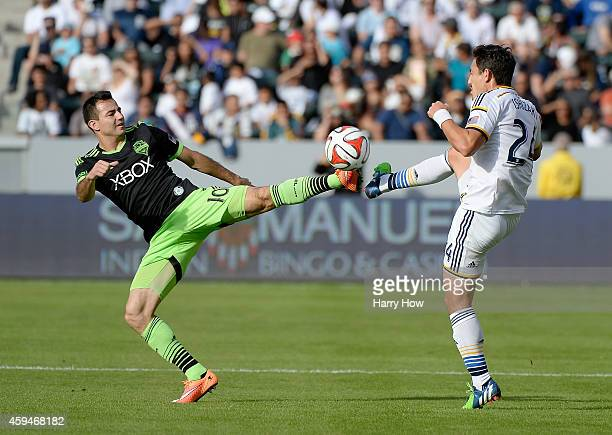 Marco Pappa of Seattle Sounders FC and Stefan Ishizaki of Los Angeles Galaxy attempt to trap the ball during the Western Conference Final at StubHub...