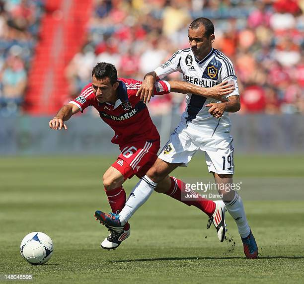 Marco Pappa of the Chicago Fire and Juninho of the Los Angeles Galaxy battle for the ball during an MLS match at Toyota Park on July 8, 2012 in...
