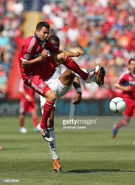 Marco Pappa of the Chicago Fire collides with David Junior Lopes of the Los Angeles Galaxy during an MLS match at Toyota Park on July 8, 2012 in...