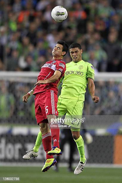 Marco Pappa of the Chicago Fire heads the ball against Lamar Neagle of the Seattle Sounders FC during the 2011 Lamar Hunt US Open Cup Final at...