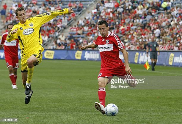 Marco Pappa of the Chicago Fire kicks the ball as Eric Brunner of the Columbus Crew defends during the first half at Toyota Park on September 20 2009...
