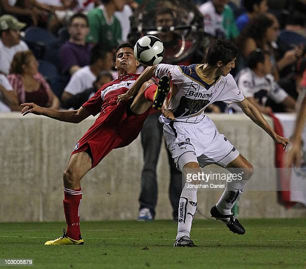Marco Pappa of the Chicago Fire kicks the ball away from Marco Palacios of Pumas UNAM during a SuperLiga 2010 match at Toyota Park on July 20 2010 in...