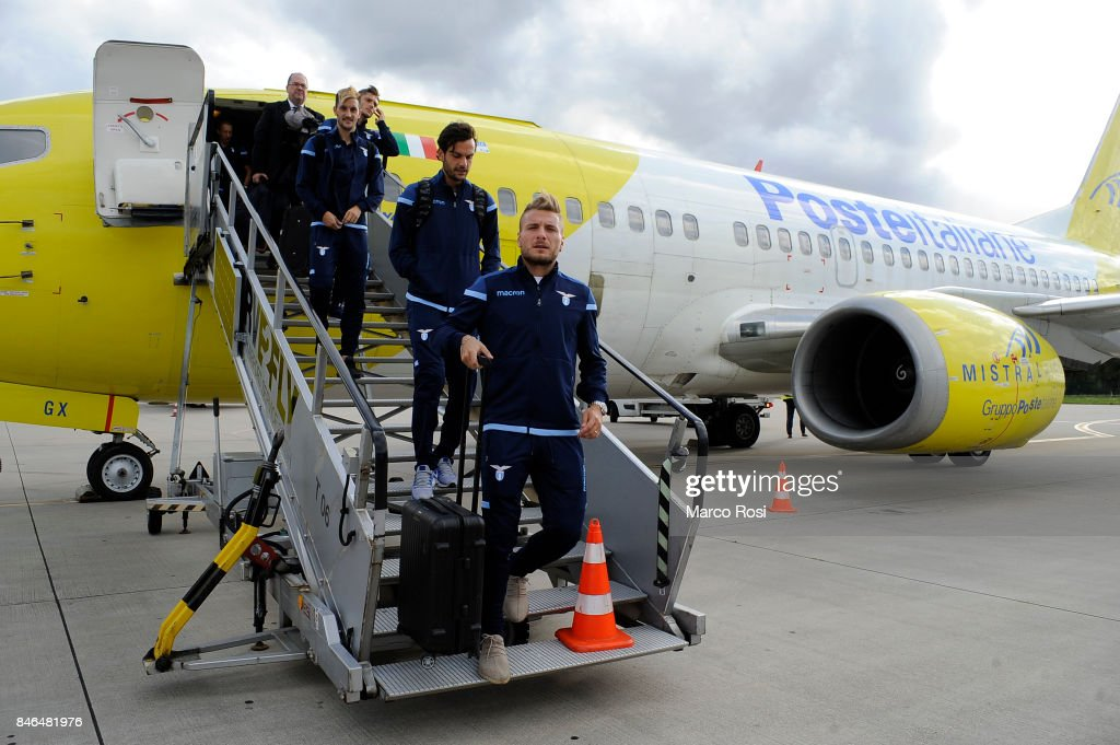 Marco Parolo and Ciro Immobile disembark the plane as SS Lazio travel to Arnhem ahead of their UEFA Europa League match against Vitesse Arnhem on September 13, 2017 in Arnhem, Netherlands.