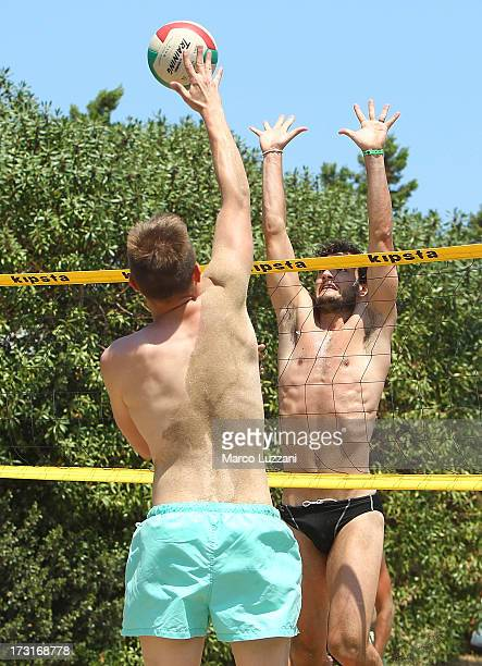 Marco Parolo and Pavol Bajza of Parma FC playing beach volleyball during Parma FC PreSeason Training Session at Rosa Marina Resort on July 8 2013 in...