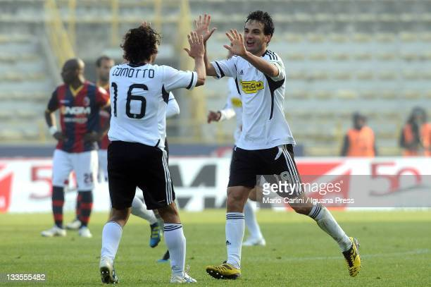 Marco Parolo of AC Cesena celebrates with teammate Gianluca Comotto after scoring the opening goal of the Serie A match between Bologna FC and AC...