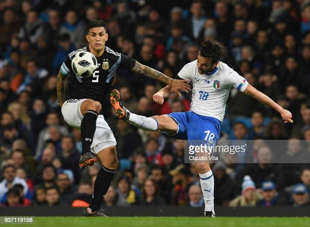 Marco Parolo of Italy competes for the ball with Leandro Paredes of Argentina during the International friendly match between Italy and Argentina at...