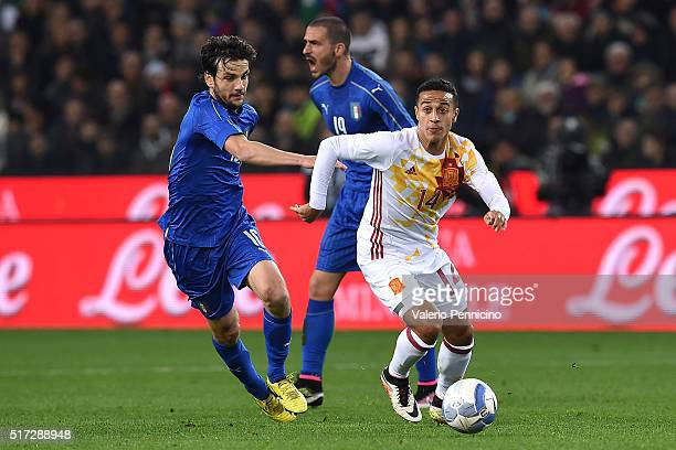 Marco Parolo of Italy competes with Thiago Alcantara of Spain during the international friendly match between Italy and Spain at Stadio Friuli on...