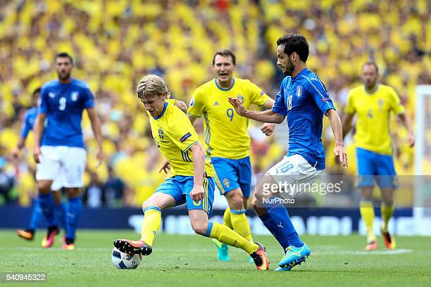 Marco Parolo of Italy is challenged by Emil Forsberg of Sweeden during the UEFA EURO 2016 Group E match between Italy and Sweden at Stadium Municipal...