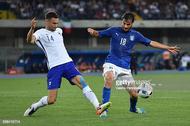 Marco Parolo of Italy is challenged by Tim Sparv of Finland during the international friendly match between Italy and Finland on June 6 2016 in...