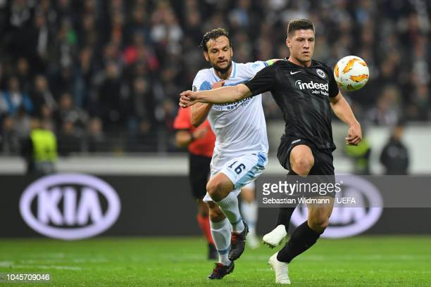 Marco Parolo of Lazio and Luka Jovic of Frankfurt compete for the ball during the UEFA Europa League Group H match between Eintracht Frankfurt and SS...