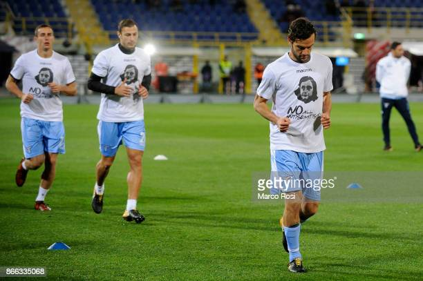 Marco Parolo of Lazio wears a shirt depicting Anne Frank saying 'no to antiSemitism' in response to antisemitic graffiti left by their fans at a...
