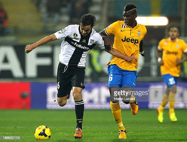 Marco Parolo of Parma FC competes for the ball with Paul Pogba of Juventus during the Serie A match between Parma FC and Juventus at Stadio Ennio...