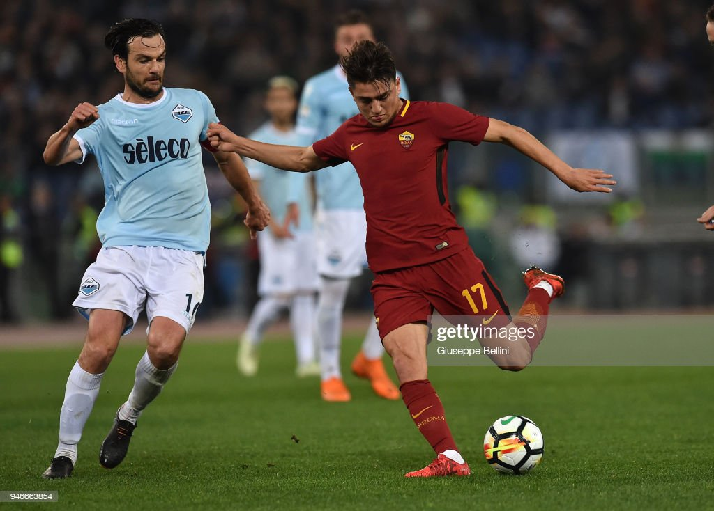 Marco Parolo of SS Lazio and Cengiz Under of AS Roma in action during the serie A match between SS Lazio and AS Roma at Stadio Olimpico on April 15, 2018 in Rome, Italy.
