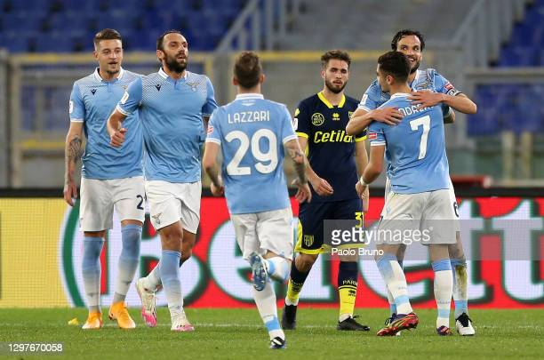 Marco Parolo of SS Lazio celebrates with Andreas Pereira and team mates after scoring their side's first goal during the Coppa Italia match between...