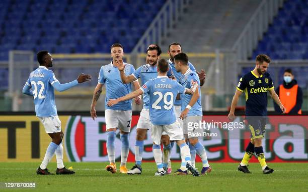 Marco Parolo of SS Lazio celebrates with Jean-Daniel Akpa Akpro, Manuel Lazzari, Andreas Pereira and team mates after scoring their side's first goal...