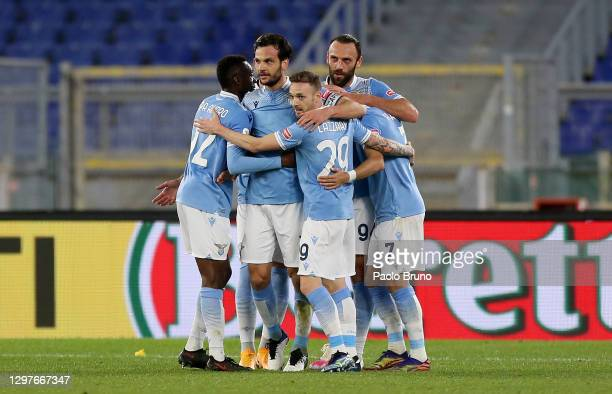 Marco Parolo of SS Lazio celebrates with team mates Jean-Daniel Akpa Akpro, Manuel Lazzari and Vedat Muriqi after scoring their side's first goal...