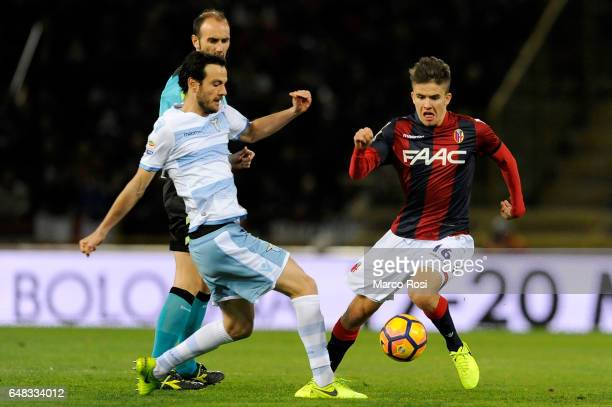 Marco Parolo of SS Lazio compete for the ball with Adam Nagy of Bologna FC during the Serie A match between Bologna FC and SS Lazio at Stadio Renato...