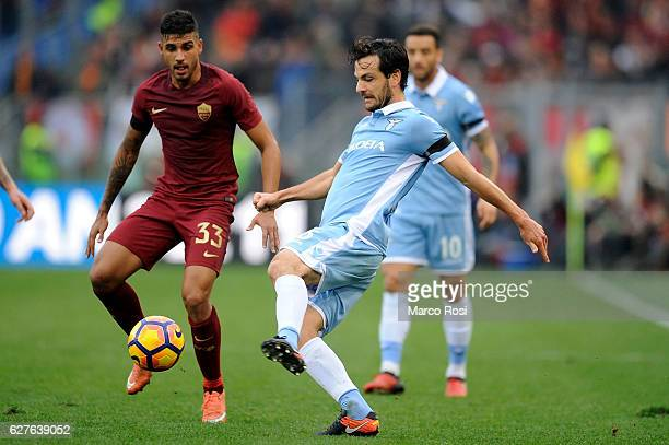 Marco Parolo of SS Lazio compete for the ball with Emerson Palmieri of AS Roma during the Serie A match between SS Lazio and AS Roma at Stadio...