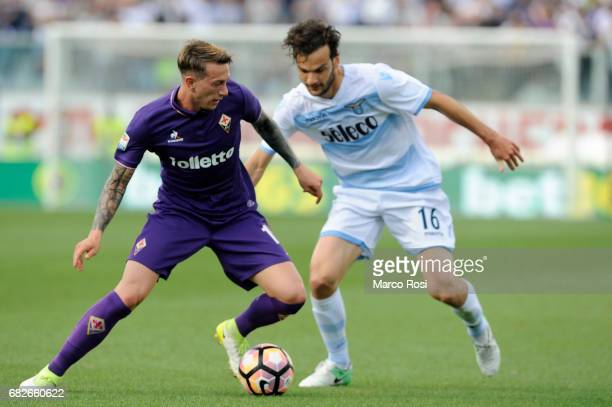 Marco Parolo of SS Lazio compete for the ball with Federico Bernardeschi of ACF Fiorentina during the Serie A match between ACF Fiorentina and SS...