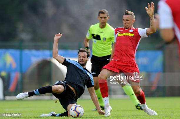 Marco Parolo of SS Lazio compete for the ball with Jasmin Kurtic of Spal during the preseason friendly match between SS Lazio and Spal on July 28...