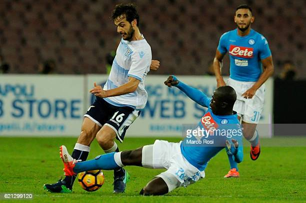 Marco Parolo of SS Lazio compete for the ball with Kalidou Koulibaly of SSC Napoli during the Serie A match between SSC Napoli and SS Lazio at Stadio...