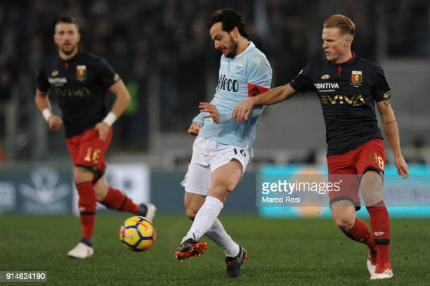 Marco Parolo of SS Lazio compete for the ball with Oscar Hiljemark of Genoa during the Serie A match between SS Lazio and Genoa at Stadio Olimpico on...
