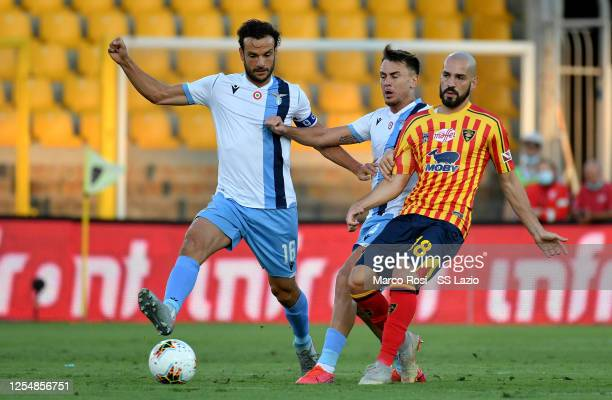 Marco Parolo of SS Lazio compete for the ball with Saponara during the Serie A match between US Lecce and SS Lazio at Stadio Via del Mare on July 07...