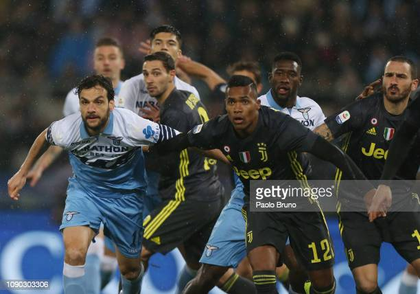 Marco Parolo of SS Lazio competes for the ball with Alex Sandro of Juventus during the Serie A match between SS Lazio and Juventus at Stadio Olimpico...