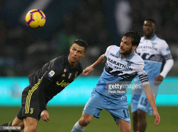 Marco Parolo of SS Lazio competes for the ball with Cristiano Ronaldo of Juventus during the Serie A match between SS Lazio and Juventus at Stadio...