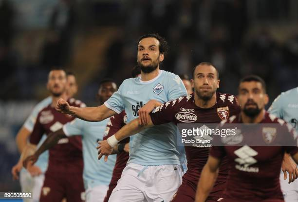 Marco Parolo of SS Lazio competes for the ball with Lorenzo De Silvestri of Torino FC during the Serie A match between SS Lazio and Torino FC at...