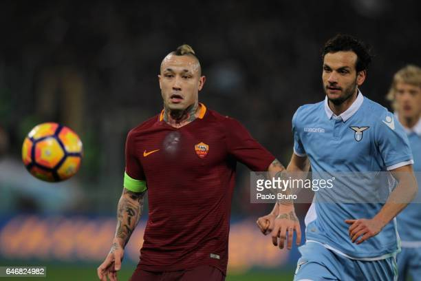Marco Parolo of SS Lazio competes for the ball with Radja Nainggolan of AS Roma during the TIM Cup match between SS Lazio and AS Roma at Olimpico...