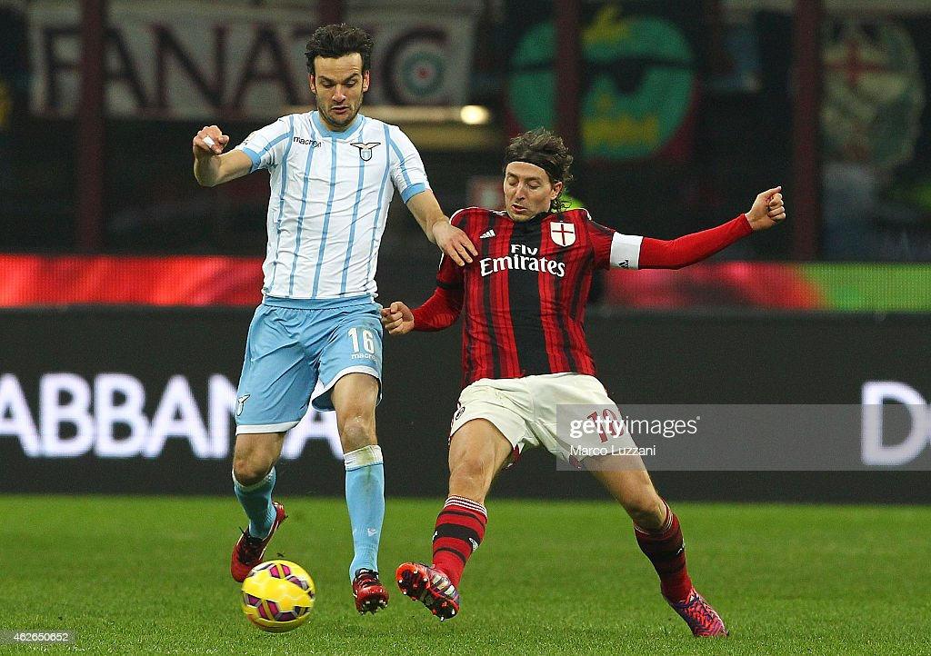Marco Parolo of SS Lazio competes for the ball with Riccardo Montolivo of AC Milan during the TIM Cup match between AC Milan and SS Lazio at Stadio Giuseppe Meazza on January 27, 2015 in Milan, Italy.