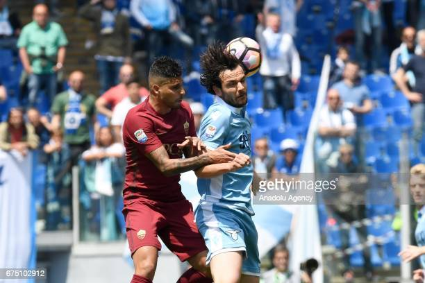 Marco Parolo of SS Lazio in action against Emerson Palmieri of AS Roma during the Italian Serie A soccer match between AS Roma and SS Lazio at Stadio...