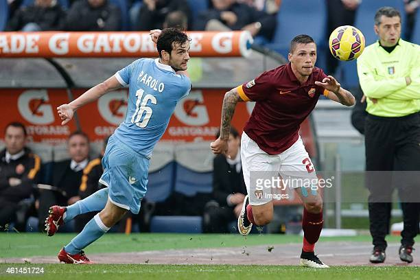 Marco Parolo of SS Lazio Jose Holebas of AS Roma during the Serie A match between AS Roma and Lazio Roma on January 112014 at the Stadio Olimpico in...