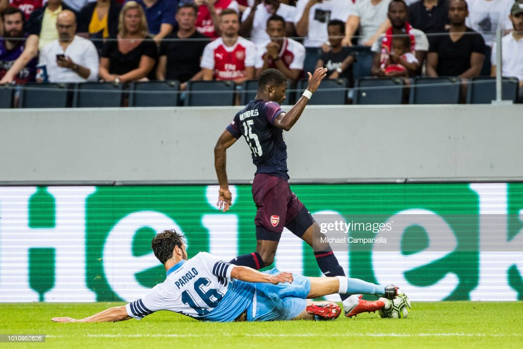 Marco Parolo of SS Lazio slides in to strip the ball from Ainsley Maitland-Niles of Arsenal FC during the Pre-season friendly between Arsenal and SS Lazio at Friends Arena on August 4, 2018 in Stockholm, Sweden.