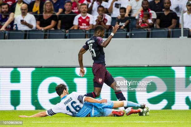 Marco Parolo of SS Lazio slides in to strip the ball from Ainsley MaitlandNiles of Arsenal FC during the Preseason friendly between Arsenal and SS...