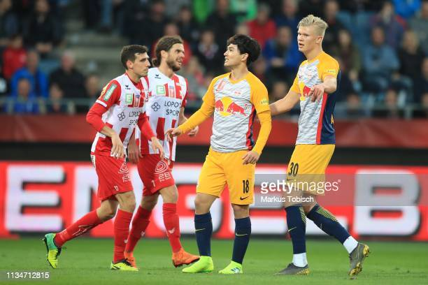 Marco Perchtold of Grazer AK Thomas Zuendel of Grazer AK Takumi Minamino of RB Salzburg and Erling Braut Haland of RB Salzburg in action during the...