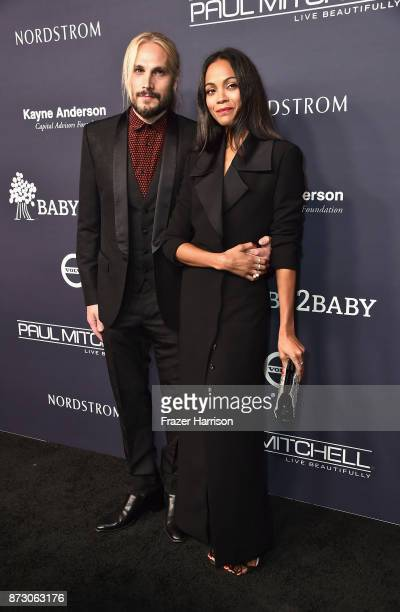 Marco Perego and Zoe Saldana attend the 2017 Baby2Baby Gala at 3LABS on November 11 2017 in Culver City California