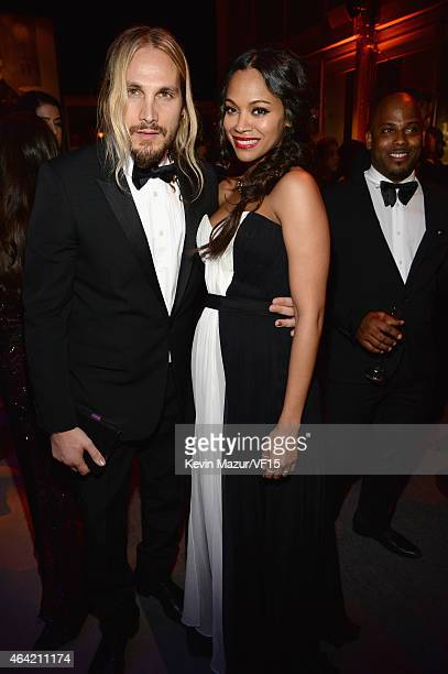 Marco Perego and Zoe Saldana attends the 2015 Vanity Fair Oscar Party hosted by Graydon Carter at the Wallis Annenberg Center for the Performing Arts...