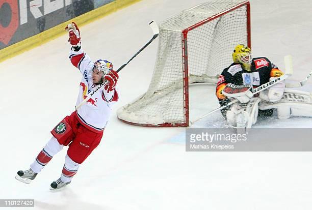 Marco Pewal of Salzburg celebrates after scoring a goal against Goalkeeper Juergen Penker of Vienna during the ErsteBank EHL match between EC Red...