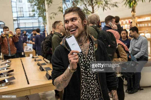 Marco Pierre White Jr poses with an iPhone X after being the first to buy one upon its release in the UK on November 3 2017 in London England The...